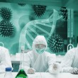 Stock Photo: Scientists working in protective suite with futuristic interface