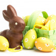 Easter eggs in a basket with chocolate bunny — Stock Photo #24148445