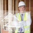 Architect standing behind white house plan interface — Stock Photo