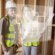 Architect and foreman checking the plans on white interface — Stock Photo #24148597