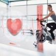 Young girl doing exercise bike with futuristic interface — Stock Photo #24148607