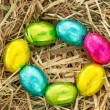 Easter eggs in a circle on straw - Stock Photo