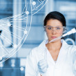 Serious chemist working with white dna helix diagram inteface — Stock Photo