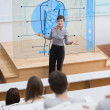 Standing teacher in front of futuristic interface asking a quest — Stock Photo