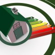Energy ratings growing from 3d house - Stock Photo