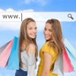 Smiling girls with their shopping bags under address bar - Stock Photo
