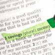 Savings money definition highlighted in green — Stock Photo #24149059