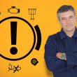 Mature mechanic standing next to car warning signals - Stock Photo