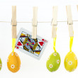 Easter eggs hanging from a line with queen of hearts — Stock Photo