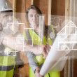 Architect and foreman looking at the plans on interface — Stock Photo