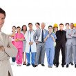 Businessman standing in front of different types of workers — Stock Photo