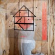 Man insulating walls following instructions on interface - Foto de Stock