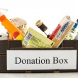 Black cardboard donation box with houseware product and food - Foto de Stock