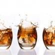 Serial arrangement of whiskey splashing in tumbler — Stock Photo #24149793
