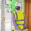 Architect looking at interface with house plan - Foto Stock