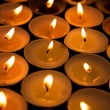 Candles lighting up the dark - Stock Photo