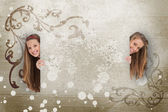 Pretty girls peeking out from behind blank space — Stock Photo