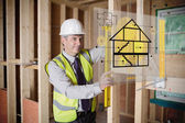 Architect using spirit level and looking at hologram interface — Foto Stock