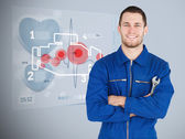 Portrait of a young mechanic with futuristic interface next to h — Stock Photo