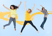 Attractive young man and women jump — Stock Photo