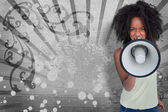 Girl with afro shouting through megaphone with space for text — Stock Photo