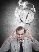 Stressed businessman with a deadline — Stock Photo