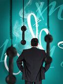 Homme d'affaires en regardant suspendu noir récepteur téléphonique — Photo
