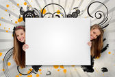 Pretty girls holding blank advertis — Stock Photo