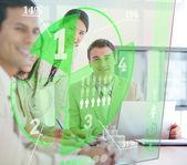 Business using green pie chart interface — Stock Photo