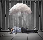 Data worker napping under cloud in data centre — Stock Photo