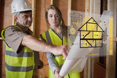 Architect and foreman consulting the plans on interface — Stock Photo