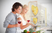 Couple making dinner using interface instructions — Stock Photo