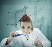 Blonde scientist working with futuristic interface and pouring — Stock Photo