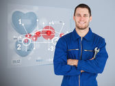 Portrait of a young mechanic next to futuristic interface — Stock Photo
