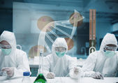 Scientists working in the lab with futuristic interface — Stock Photo