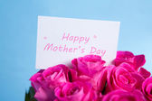 Bouquet of pink roses with mothers day card — Stock Photo