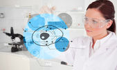 Chemist examining cell interface — Stock Photo