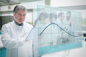 Confident scientist working with tablet and futuristic interface — Stock Photo