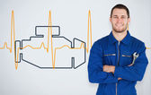 Portrait of a young mechanic next to background with car engine — Stock Photo