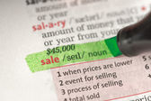 Sale definition highlighted in green — Stock Photo