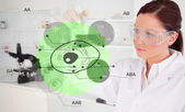 Chemist examining green cell interface — Stock Photo