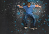 Cool young skateboarder doing an ollie trick — Stock Photo