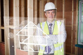 Architect standing behind white house plan interface — Foto Stock