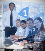 Smiling business using blue pie chart interface — Stock Photo