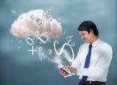 Happy businessman connecting to cloud computing — Stock Photo
