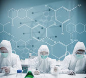Chemists working in protective suit with futuristic interface sh — Photo