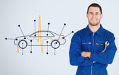 Portrait of a young mechanic next to background with car — Foto de Stock
