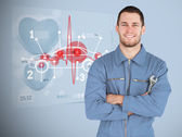 Portrait of a young mechanic next to futuristic interface with d — Stock Photo