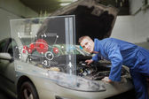 Mechanic with open hood consulting interface — Stock Photo