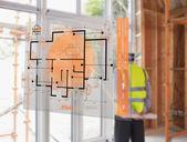 Architetto guardando fuori la finestra con l'interfaccia di ologramma in foregrou — Foto Stock